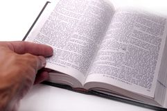 Hand on open book Stock Photography