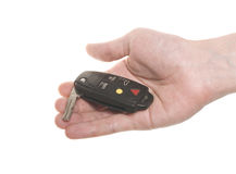 Hand with open car's key. Isolated over white Stock Photography