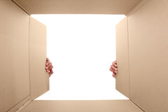 Hand open cardboard box Stock Photography