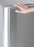 Hand open freezer Royalty Free Stock Photography