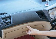 Hand man open glove compartment in car. Hand open glove compartment box in car royalty free stock photos