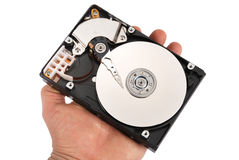 Hand with a open hard disk drive Stock Photo
