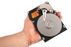 Hand with a open hard disk drive Royalty Free Stock Photo