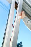 Hand open plastic window Royalty Free Stock Photo