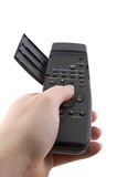Hand with open remote control Stock Image