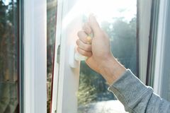 Hand open window royalty free stock photo