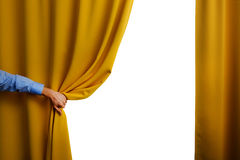 Hand open yellow curtain. On white background Stock Images