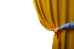 Hand open yellow curtain. On white background Royalty Free Stock Image