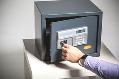 Hand opened a safe Stock Image