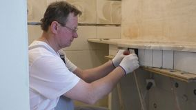 A hand and opened a water faucet. Plumber is checking a serviceability of a trap stock footage