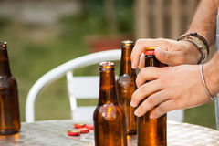Hand opening a beer bottle Royalty Free Stock Photos