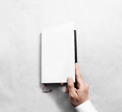 Hand opening blank white book cover mockup template. Stock Images