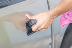Hand opening blond car door Royalty Free Stock Image