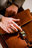 Hand opening briefcase Royalty Free Stock Photos