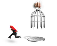 Hand opening cage and man carrying arrow up symbol running. Hand opening the cage and man carrying red arrow up symbol running, isolated on white background royalty free stock images