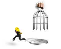 Hand opening cage and man carrying dollar sign running Stock Photography