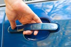 Hand opening car door. Male hand opening car door Stock Photo