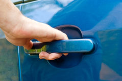 Hand opening car door Stock Image