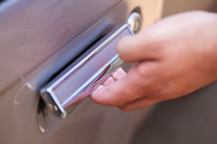 Hand opening car door Royalty Free Stock Image