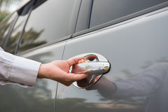 Hand opening car door Royalty Free Stock Photography