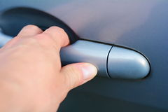 Hand opening the car door Royalty Free Stock Image