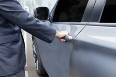 Hand opening the car handle Stock Image