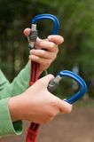 Hand opening carabiner mountain Stock Photography