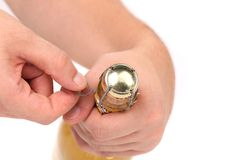 Hand opening champagne bottle Stock Photography