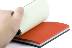 Hand opening colorful notepad Royalty Free Stock Image