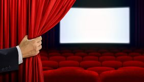 Hand opening curtain before movie show Stock Image