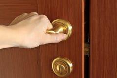 Hand opening door Stock Photo
