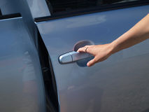 The hand opening a door of the car Stock Image
