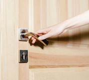 Hand opening the door Royalty Free Stock Images