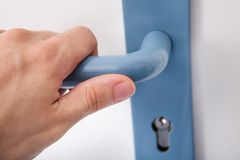 Hand opening the door handle Stock Photos