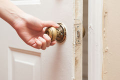 Hand opening the door Royalty Free Stock Photography