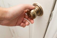 Hand opening the door Stock Images
