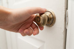 Hand opening the door Royalty Free Stock Photos