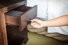 Hand Opening drawer Stock Images