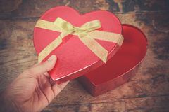Hand opening heart shaped box Royalty Free Stock Images