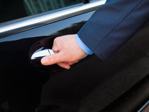 Hand opening limousine door Stock Image