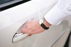 Hand opening luxury car door. Businessman opening luxury car door Stock Photography