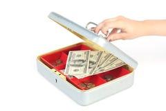 Hand opening money box on white. Hand opening box with dollars on white background Stock Photos