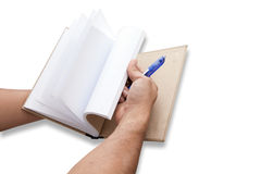 Hand is opening notebook Royalty Free Stock Photos