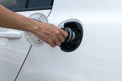 Hand opening the oil filler cap Stock Photo
