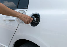 Hand opening the oil filler cap Stock Photography