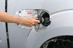 Hand opening the oil filler cap Royalty Free Stock Images