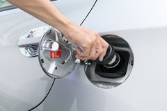 Hand opening the oil filler cap Royalty Free Stock Image