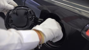 Hand opening the oil filler cap. He shows how to fill the fuel tank stock video footage