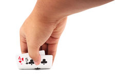 Hand opening a poker cards from table. Close up of man hand opening a poker cards from table. isolated on white background with clipping path Stock Photos