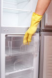 Hand opening refrigerator. Royalty Free Stock Photos